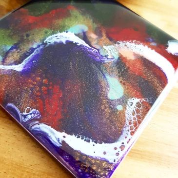 Set of 4 coasters Colours on coaster are black, red, violet and beautiful white lacing cell details.