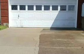 pressure washing driveway by Clean Way Detail