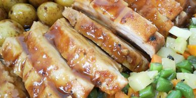 Barbecue baked pork ribs with marbled potatoes and vegetables.