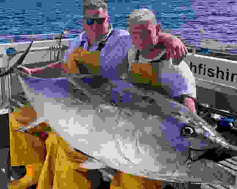 nigel and jack with a giant blue tuna they just caught onboard seawatch at falmouth
