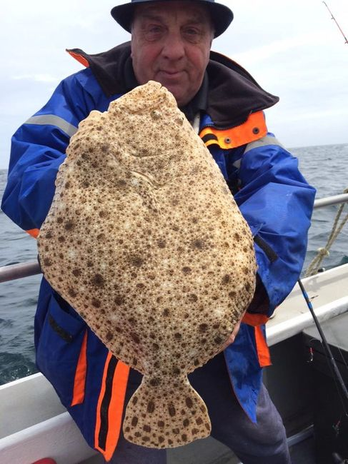 Angler Holding a Turbot Onboard Seawatch from Mylor Harbour Cornwall during a Half Day fishing Trip