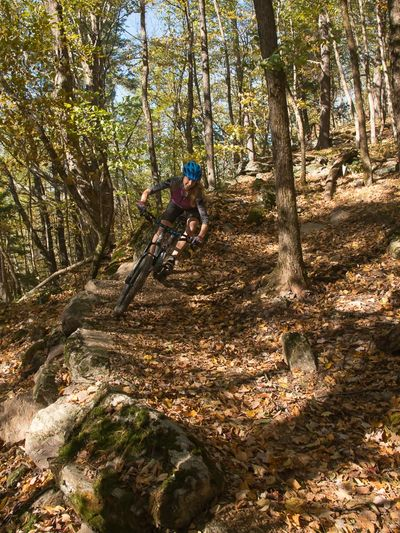 A female rides a mountain bike on the Fairgrounds Trails