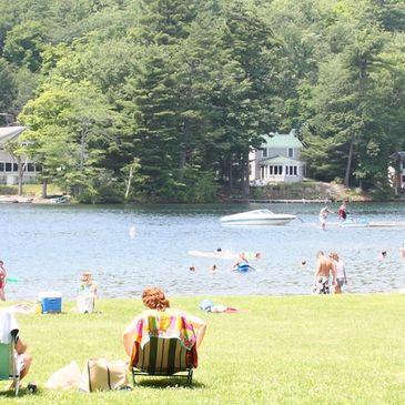 A lake with beachgoers on a summer day