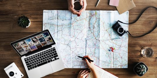 Travel planning with a map spread out