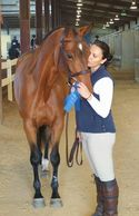 Happy new owner with her bay horse