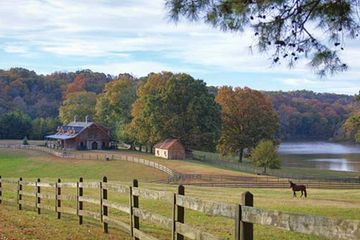 picture of a farm house and horse pastures