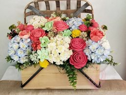 Large centerpiece with assorted wood flowers from Pink Lion Design Company