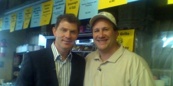 Owner Rich Belfer and Chef Bobby Flay standing together behind the counter at the White Rose Diner.