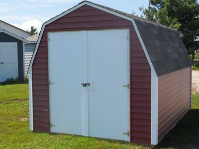 8' x 12 ' Gambrel Storage Buildng  with red vinyl siding.