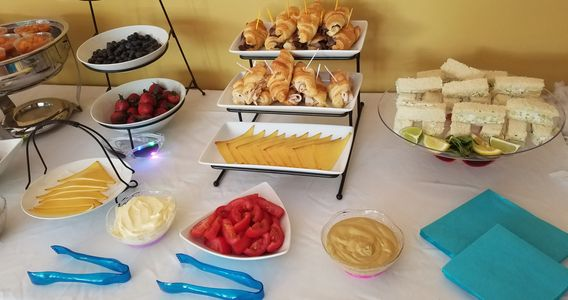 Tea party, shrimp and grits, croissant sammies, cucumber sammies, strawberries and blueberries.
