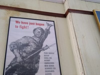 "Poster that reads ""We have just begun the fight!"" and pictures a soldier under the title."
