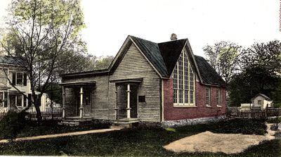 Color photo of an old historic Vineland House that is red and brown.