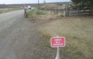 "Roadside ""Owner Will Maintain"" sign"