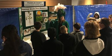 FCNWCB Education Coordinator Betsy Crysel in her Scotch thistle costume speaks to a school group.
