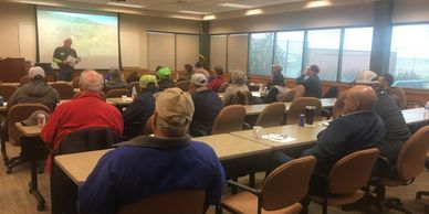 Staff speaking at an applicator training