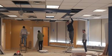 Acoustical Suspended ceiling installation in progress - Drop Ceiling Team T-bar ceilings installers in Toronto Canada