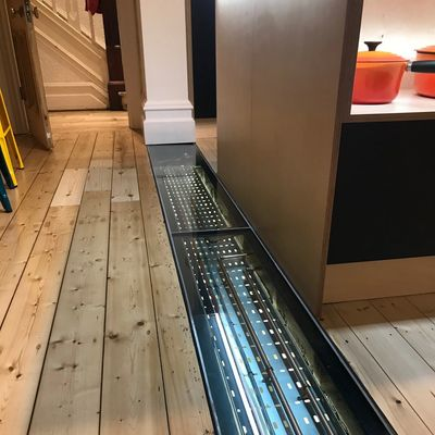 Glass kitchen floor panel
