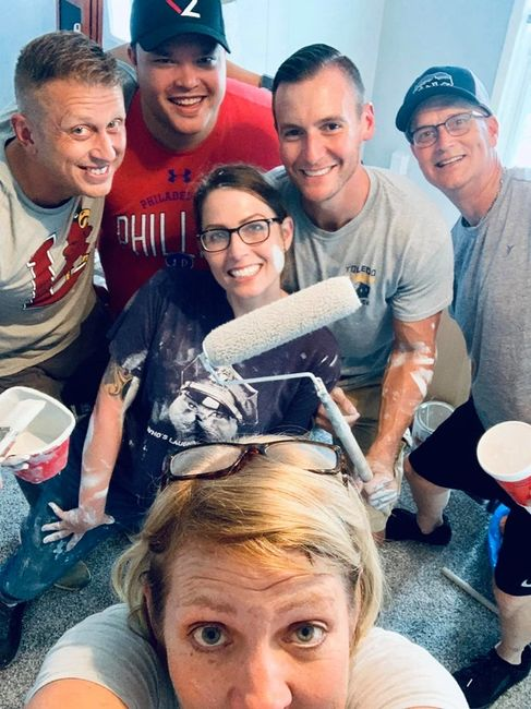 The L.M.P.D. SVU Detectives helping to paint the Free2Hope House.
