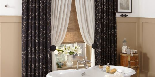 Draperies, quality and affordable window treatments, over a bathroom in Panama City Florida