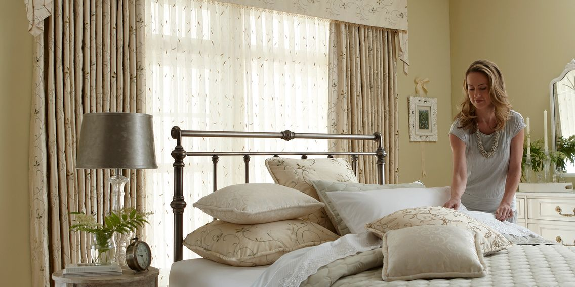Draperies, quality and affordable window treatments, over a bedroom in Panama City Florida