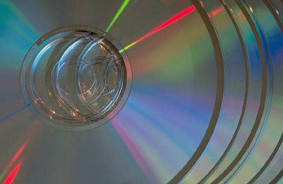 Stack of CDs from Banded Moon Arts and Media. We convert many types of tape to/from CD, DVD or more.