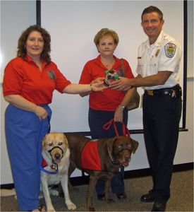 Club members presenting pet oxygen rescue mask set to a local fire department.