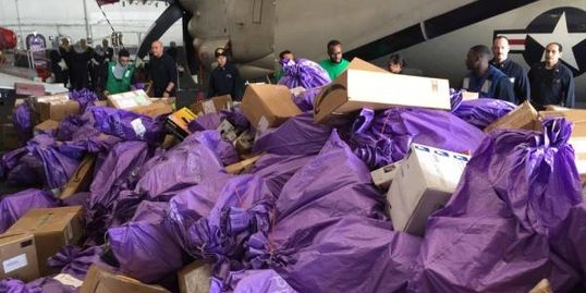 Sorting mail received on the USS Theodore Roosevelt