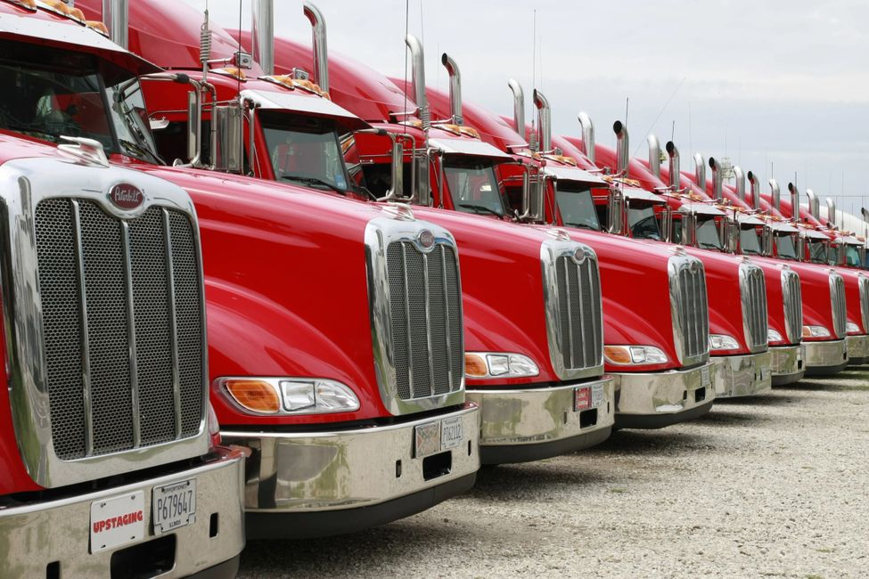 red semi trucks lined up