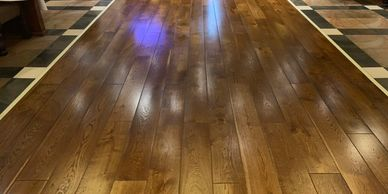 Distressed engineered wood plank flooring supplied, installed and finished on-site by FloorIT