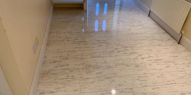 High gloss shine Laminate wood flooring supplied and installed by FloorIT