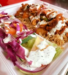 New York grill chicken kebab, rice and salad with tzatziki sauce