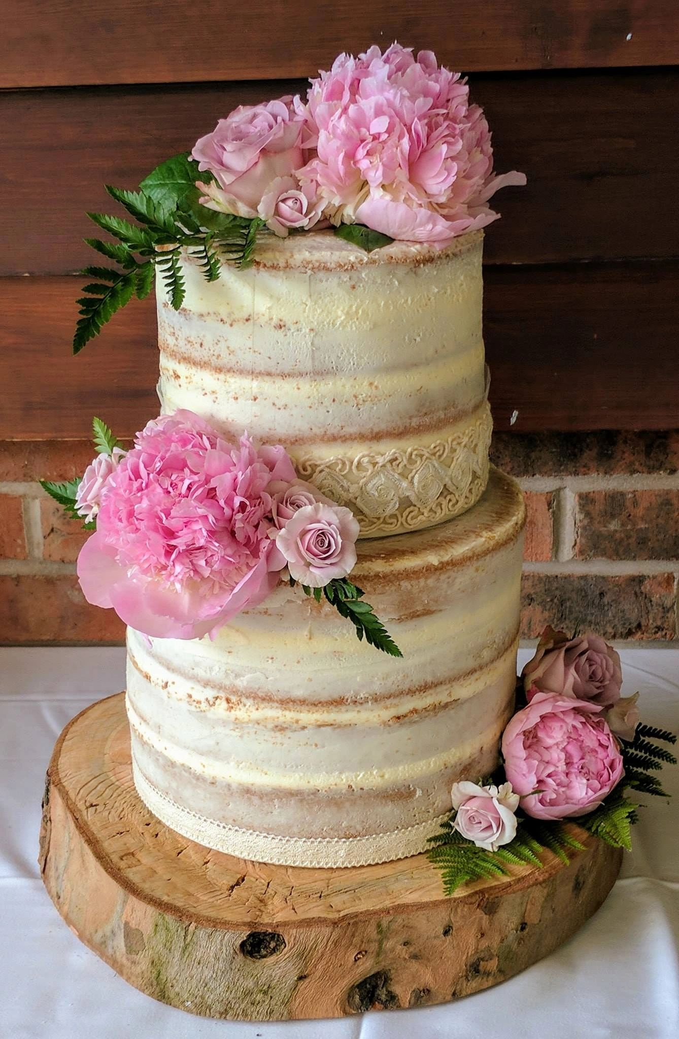 2 Tier semi naked cake with fresh flowers