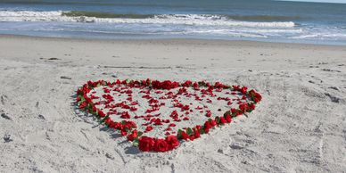 heart of roses in the sand