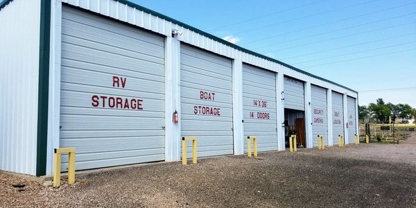 Our popular totally enclosed storage units with concrete fllor and 14 ft garage doors.