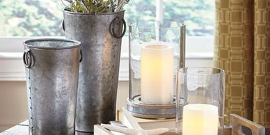 metal  vases with lavendar, white candles in glass candle holders