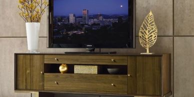 wood modern contemporary media console with tv sitting on it