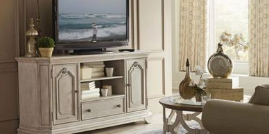 white traditional styled media console with tv sitting on it