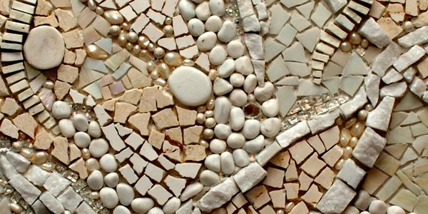 mosaic art piece made with neutral colors. The mosaic is made of stone, glass, beads, mirror, tile