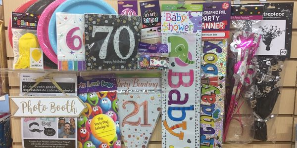 Party supplies, balloons, banners, bunting, confetti, plates, napkins, decorations, pinatas, badges