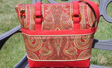 red, brown paisley bag, purse
