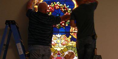 Installing stained glass.