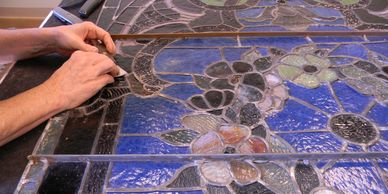 Art Glass Ensembles repairs stained glass windows too.