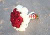 rose bouquet only comes with one color rose unless you order wedding party flowers too!