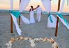 bamboo canopy with white silks and turqouise accents. Shown here with the shell-a-bration!