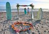 bamboo arch with tropical mix and aqua fabric.  Shown with two surfboards and the tropical silk heart!