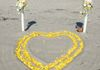 double heart made from yellow petals.  Shown here also with the 2 flower stands.