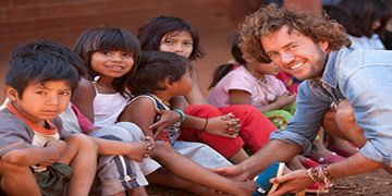 TOMS Founder Blake Mycoskie gives to needy