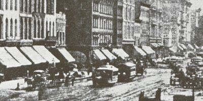 "Randolph Street in Chicago in mid-1800's A common street sign read ""No bottom to this mud."""