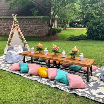 glamping picnic table and poufs with Upcountry Camp in Mississippi
