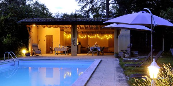 Large heated pool with built in BBQ - ready for a relaxing dinner.